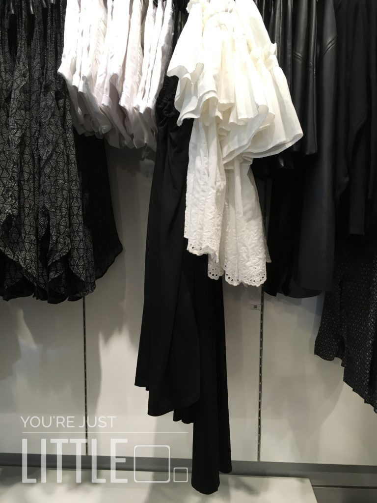 You're Just Little - clothes shopping, perspective of a rail of clothes that are above my head level