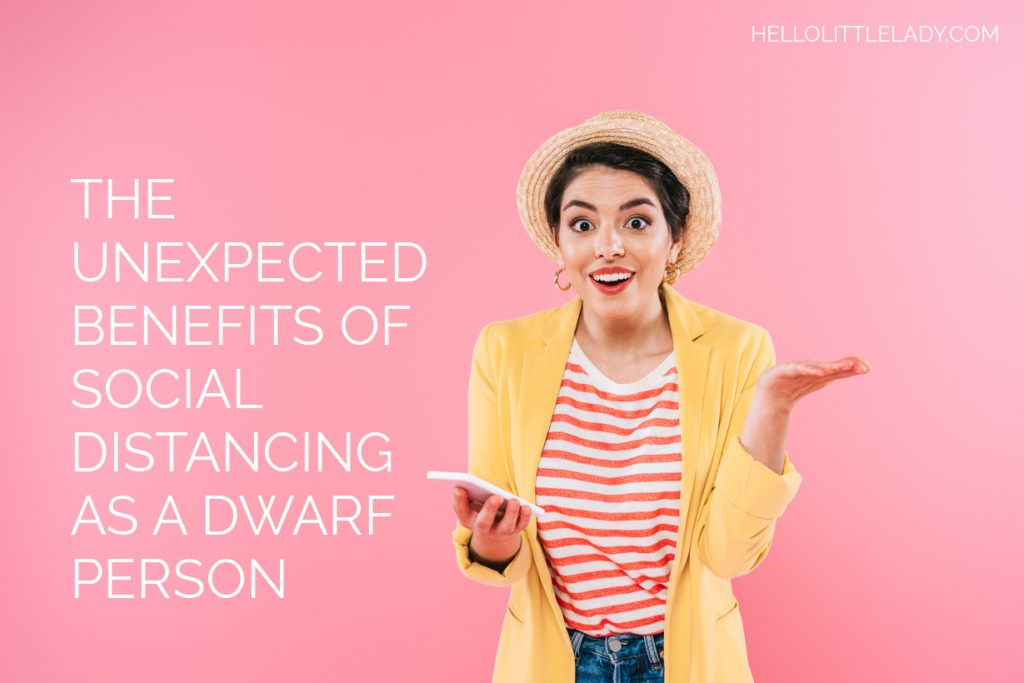 Blog Post: Photo of a young woman with a hat on with left palm of hand upwards and phone in her right hand with an surprised happy face. Includes blog post title - The Unexpected Benefits of Social Distancing As A Dwarf Person