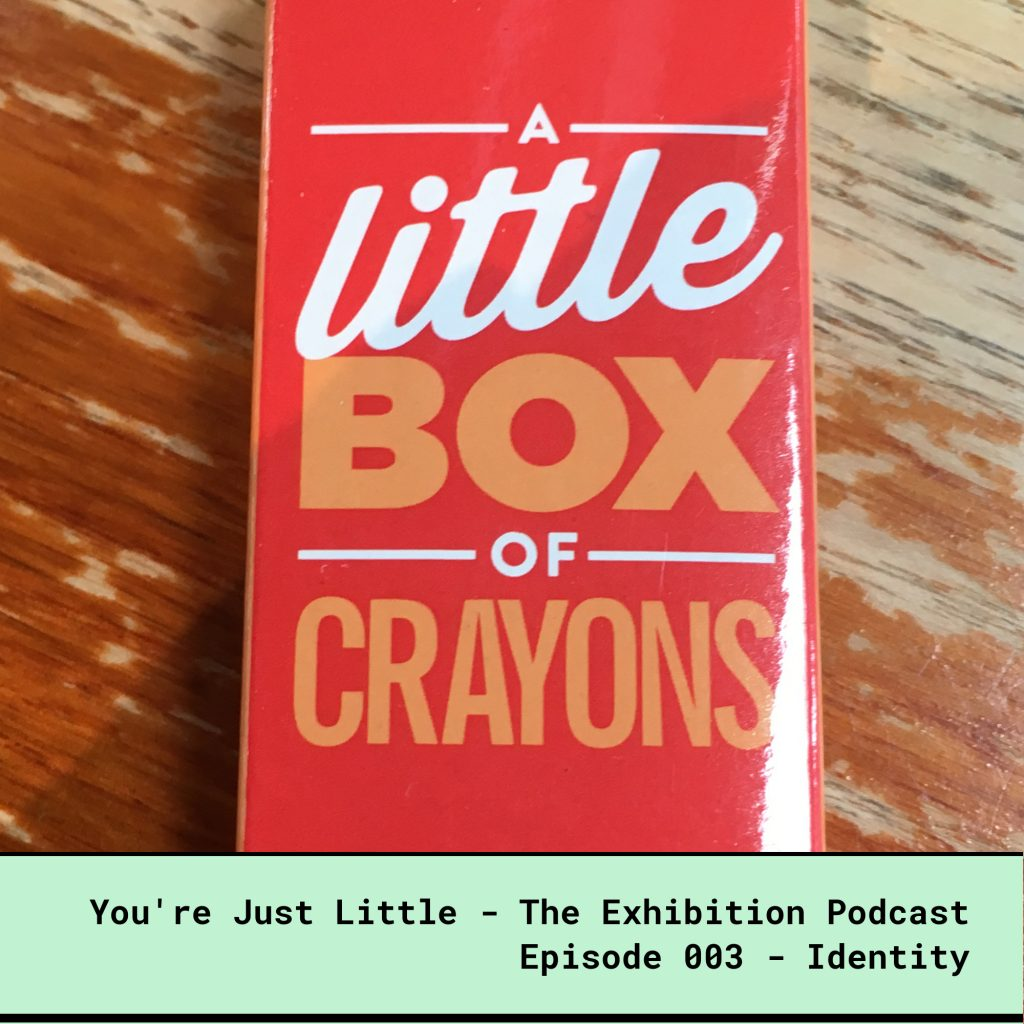 You're Just Little -The Exhibition Podcast - Episode 3 - Identity - Red box of crayons with the words A Little Box of Crayons